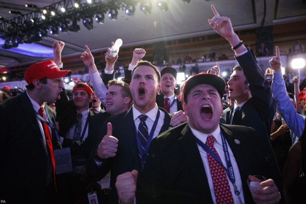 Supporters of Donald Trump cheer as they watch election results coming in