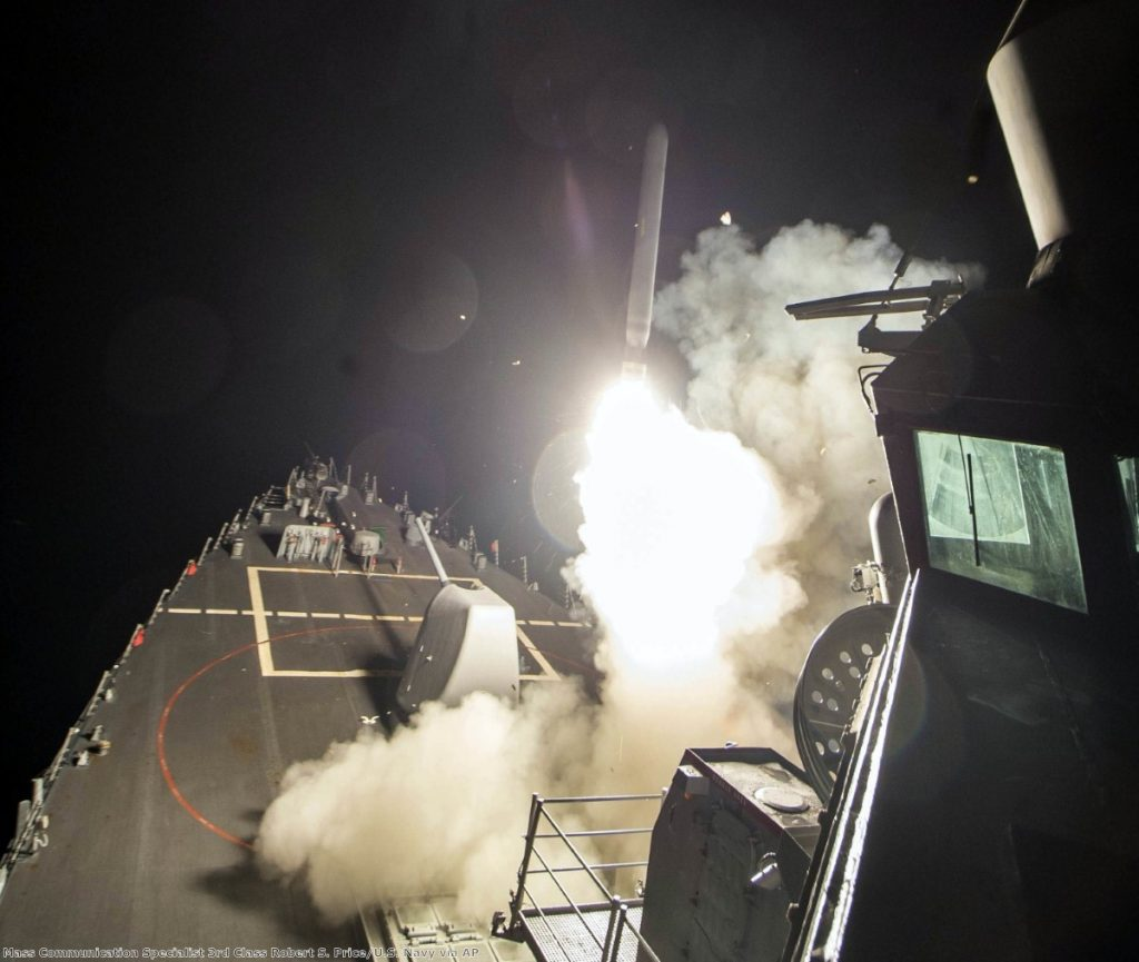 The USS Ross (DDG 71) fires a tomahawk land attack missile Friday, April 7, 2017, from the Mediterranean Sea