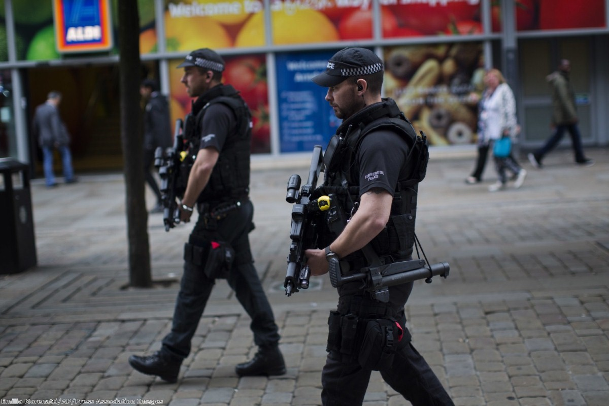 Police officers patrol in central Manchester after Monday's terror attack
