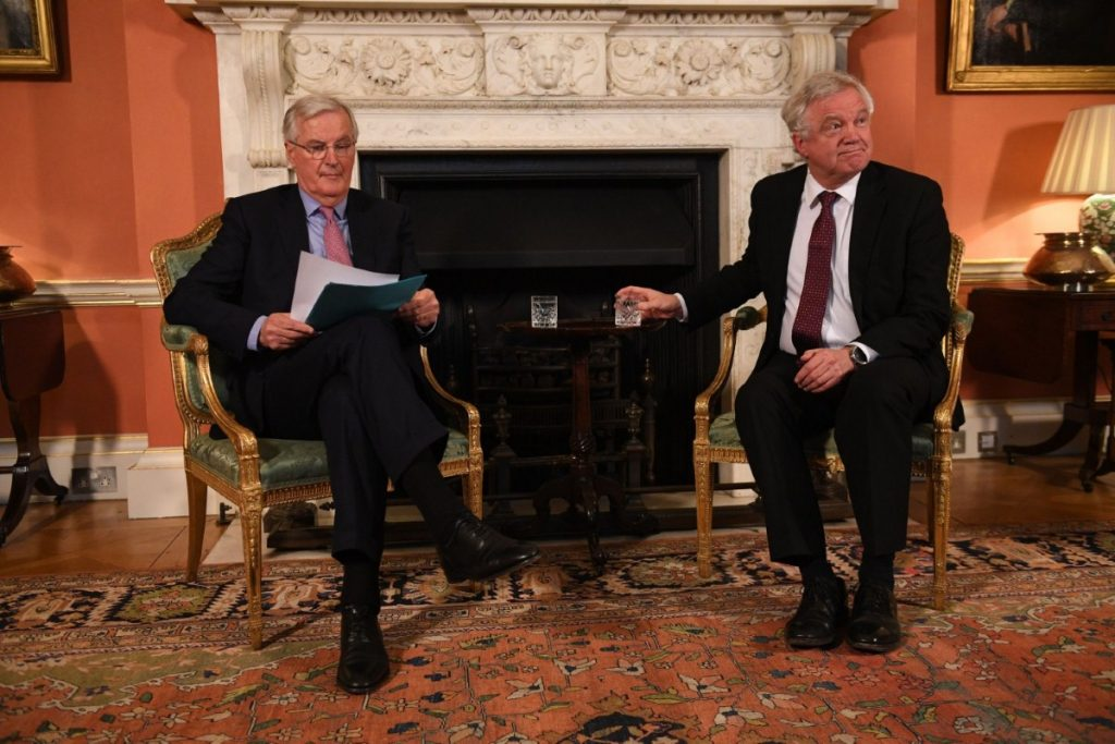 European Commission negotiator Michel Barnier sits with Davis in No.10 last month.