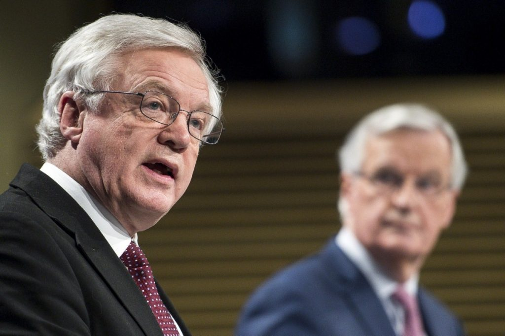 David Davis addresses journalists as Michel Barnier looks on during their press conference today.