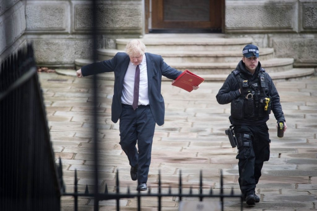 The foreign secretary waves his arms around as he arrives in Downing Street for a Cabinet meeting.