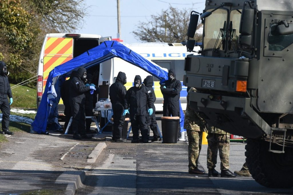 Police and army personnel suit up on Larkhill Road in Durrington, Salisbury, during the investigation into the attack on Sergei and Yulia Skripal