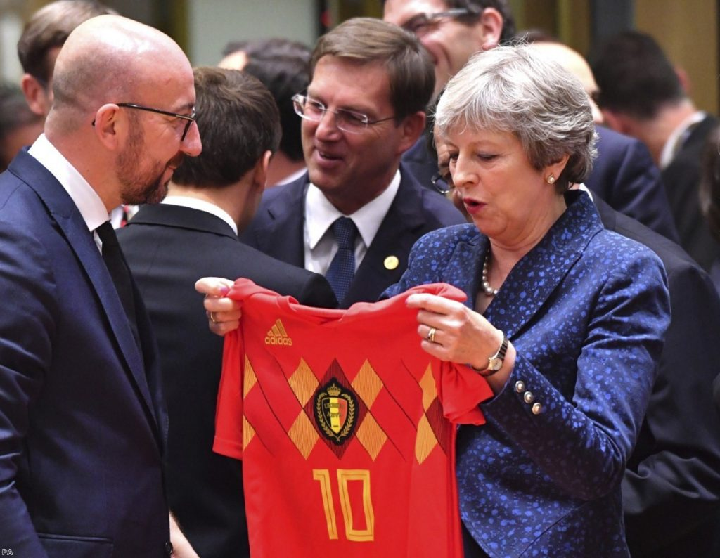 Charles Michel presents a Belgian team jersey to Theresa May during EU summit in Brussels | Copyright: PA
