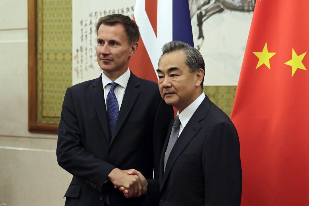 Jeremy Hunt shakes hands with Wang Yi before their meeting in Beijing | Copyright: iStock