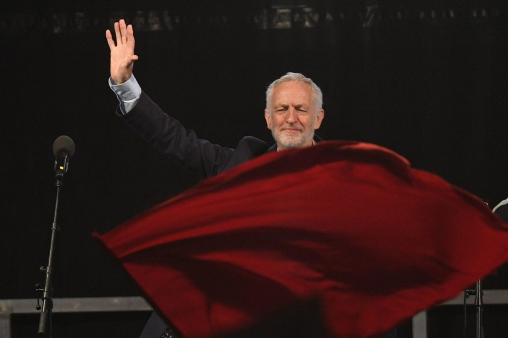 A red flag flies yesterday as Corbyn speaks at a rally at Pier Head in Liverpool, ahead of party conference