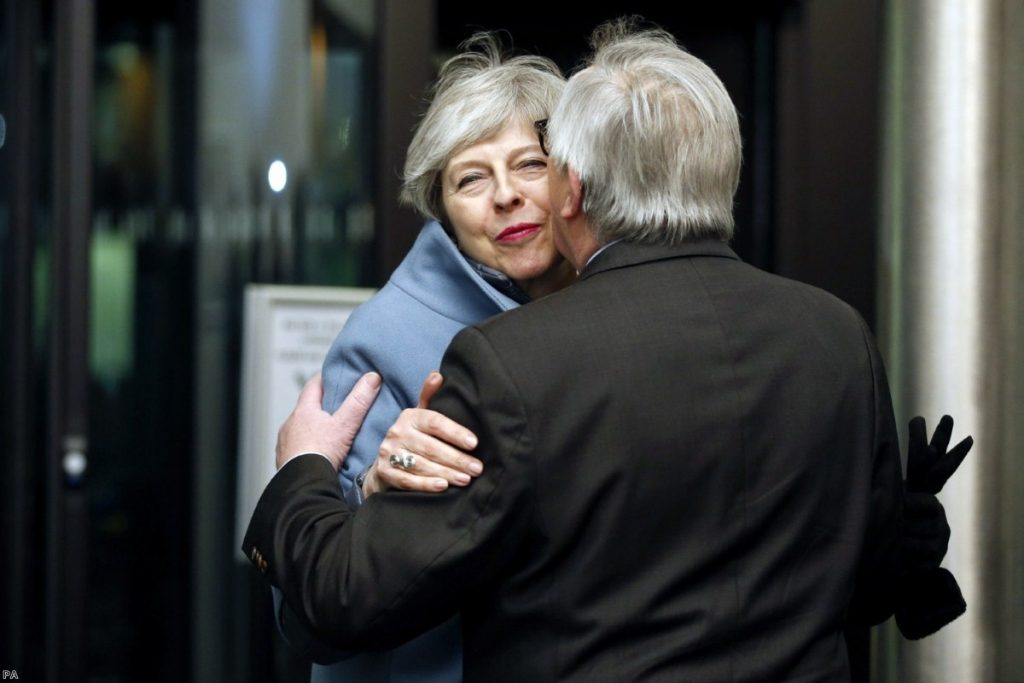 May, background is welcomed by Juncker in Strasbourg yesterday evening