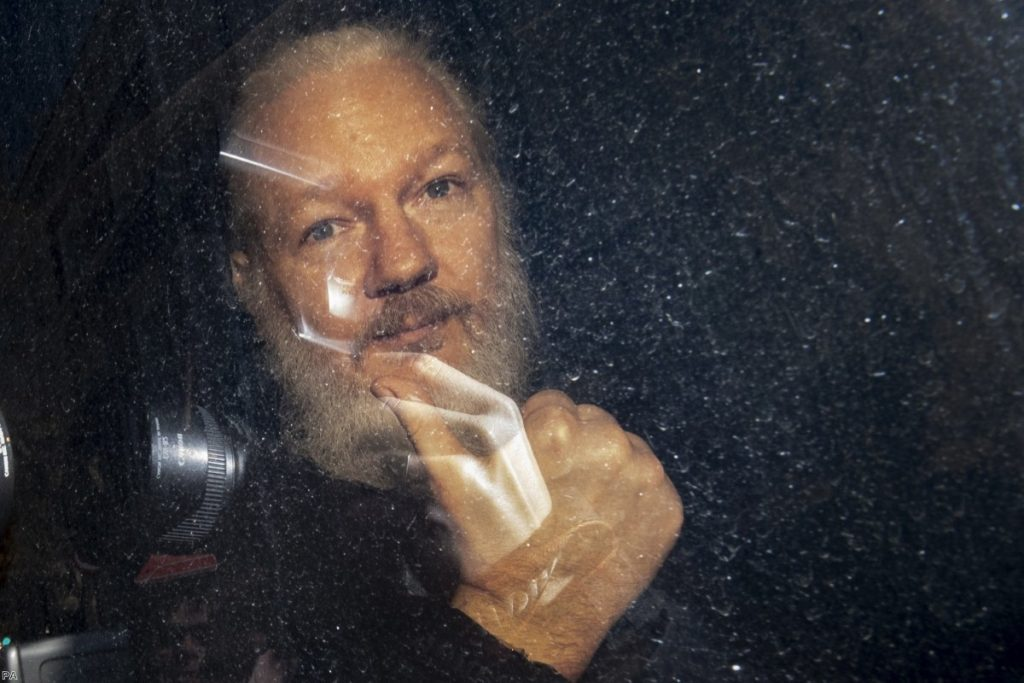 Julian Assange arrives at Westminster Magistrates' Court yesterday.