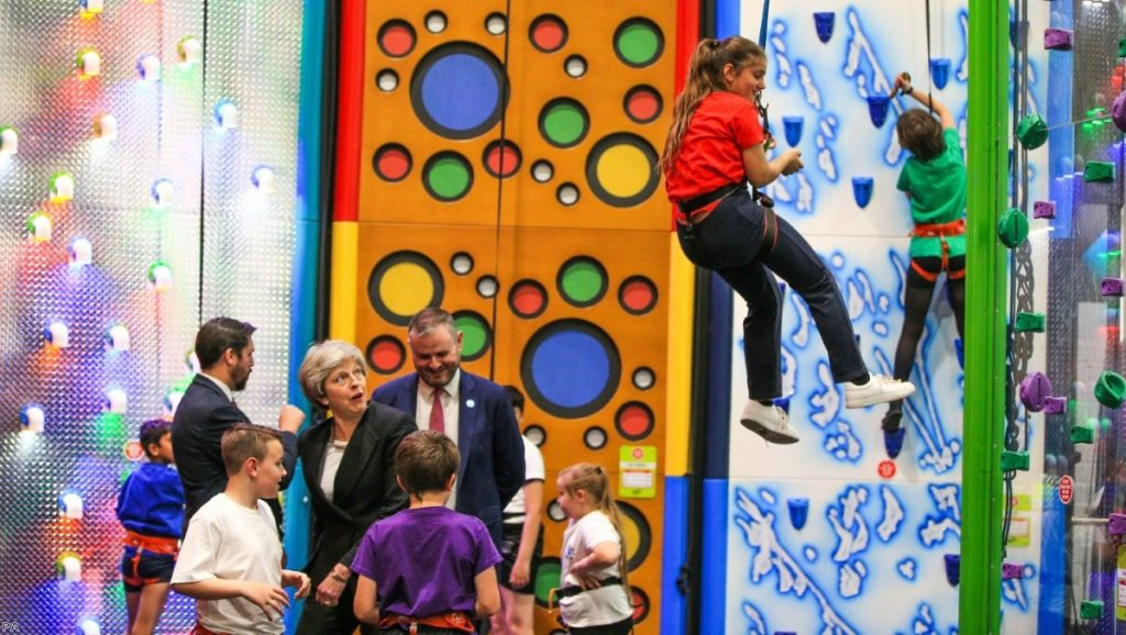 Theresa May watches children climbing while on the local election campaign trial. Faith in her Brexit policy is now almost completely eroded.