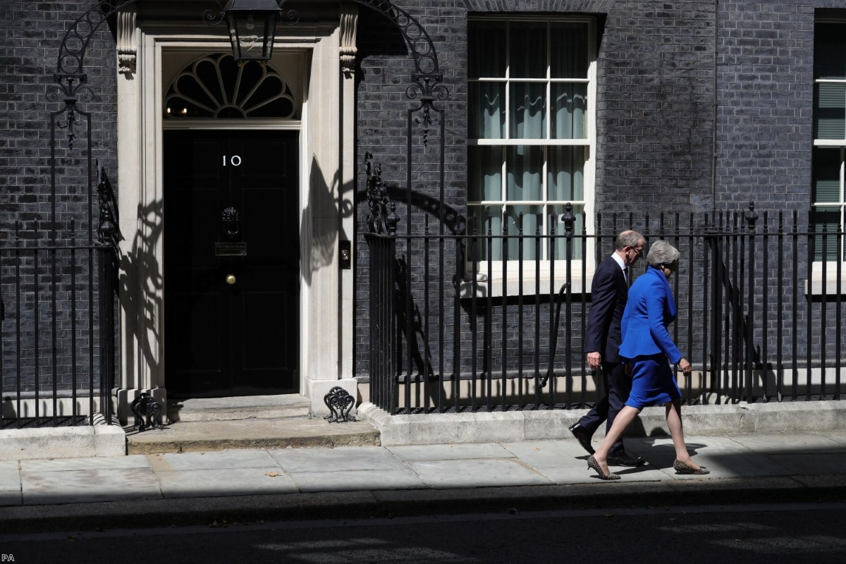 Departure: May leaves Downing Street for the last time with her husband