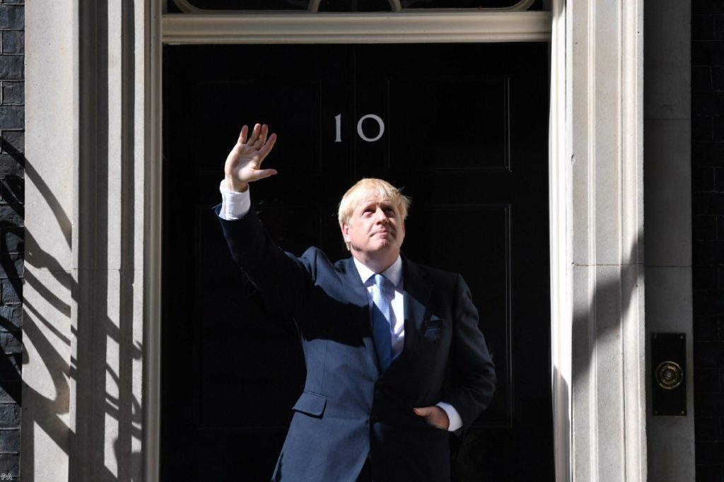 Johnson outside No.10 after he returns from seeing the Queen