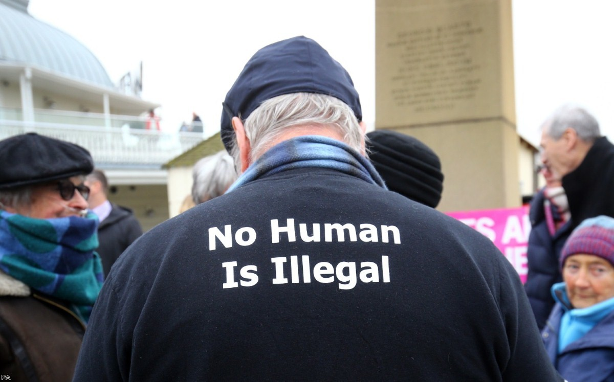 Members of the Kent Anti-Racism Network hold a vigil in Ramsgate to welcome refugees.