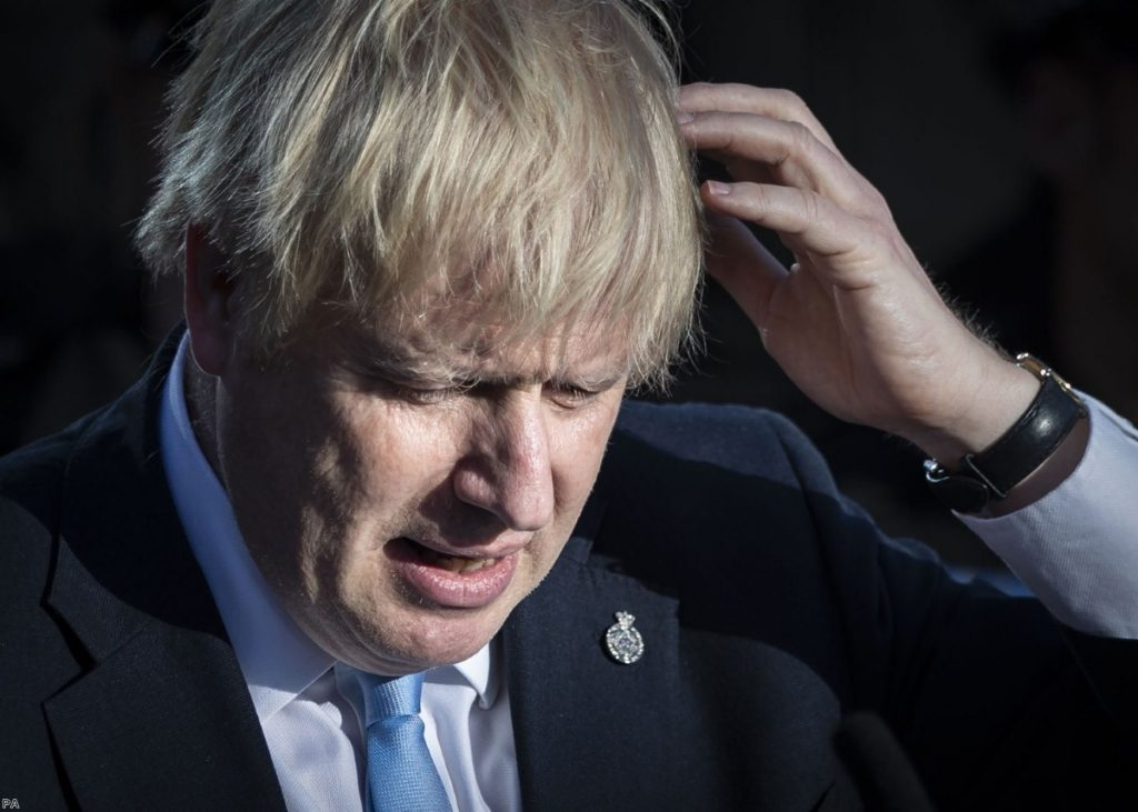 Johnson cut a strained-looking figure at the speech this afternoon.