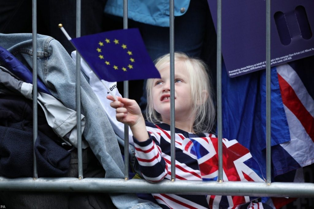 A young protester waves an EU flag at the People's Vote march on Saturday