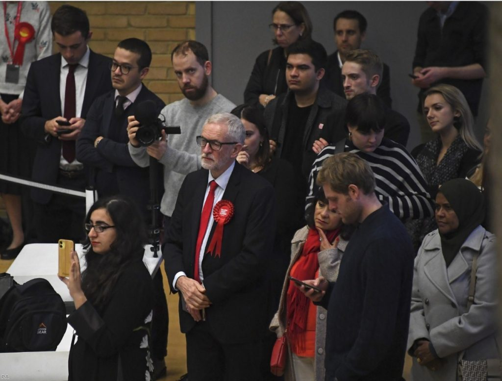 Jeremy Corbyn and his wife Laura Alvarez wait for the declaration of his seat as Labour seats fell across the country.