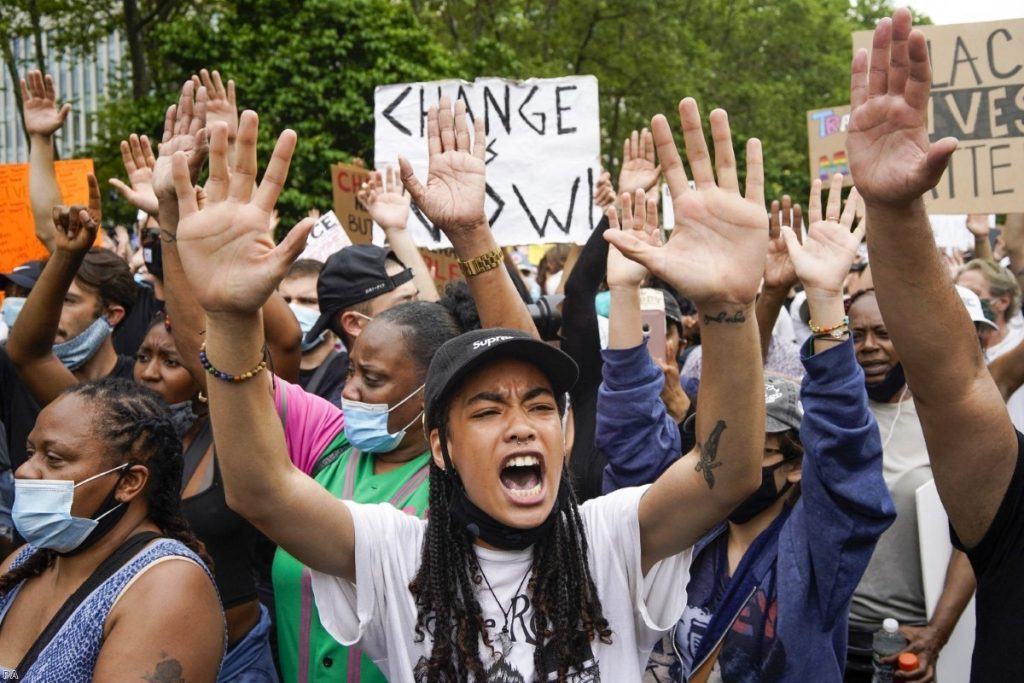 Protesters demonstrate in New York on Thursday as outrage continues to grow over the death of George Floyd.
