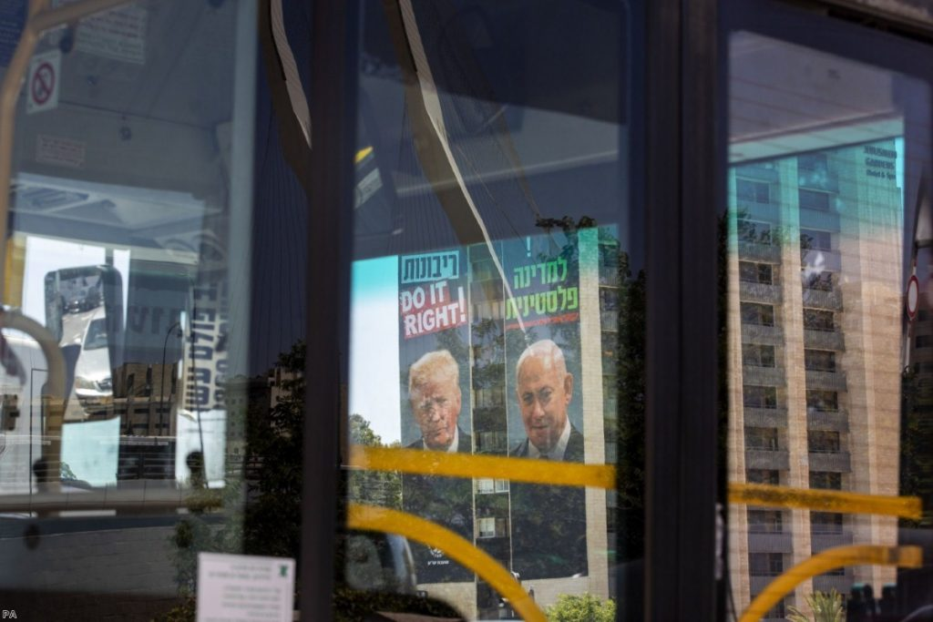 Billboards in Jerusalem placed by Yesha Council, an organisation of municipal councils of Jewish settlements in the West Bank, show Benjamin Netanyahu alongside Donald Trump.