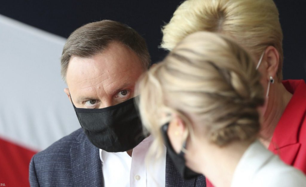 President Andrzej Duda casts his vote at a polling station in his hometown of Krakow, Poland, last Sunday.