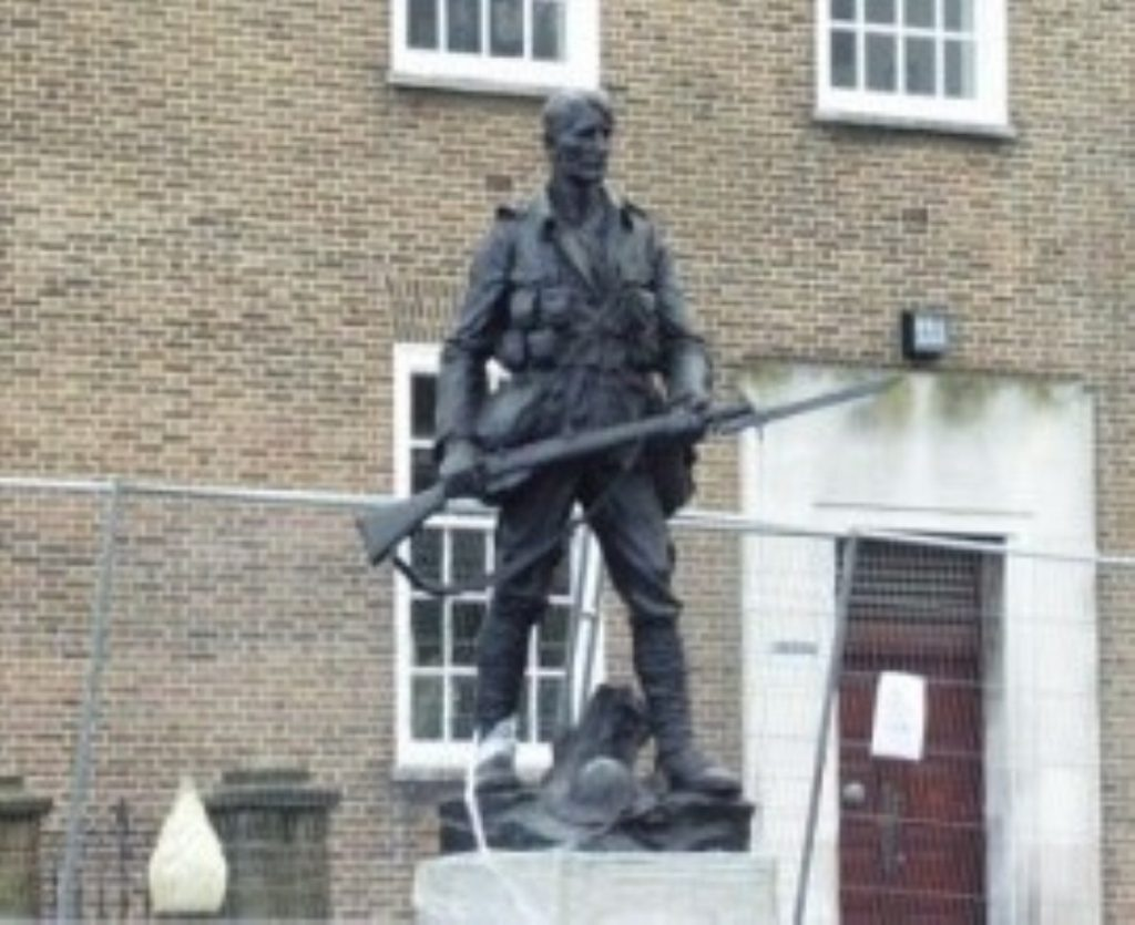 A statue of a war veteran in London. Polls show most people don't approve of the government using ground troops.