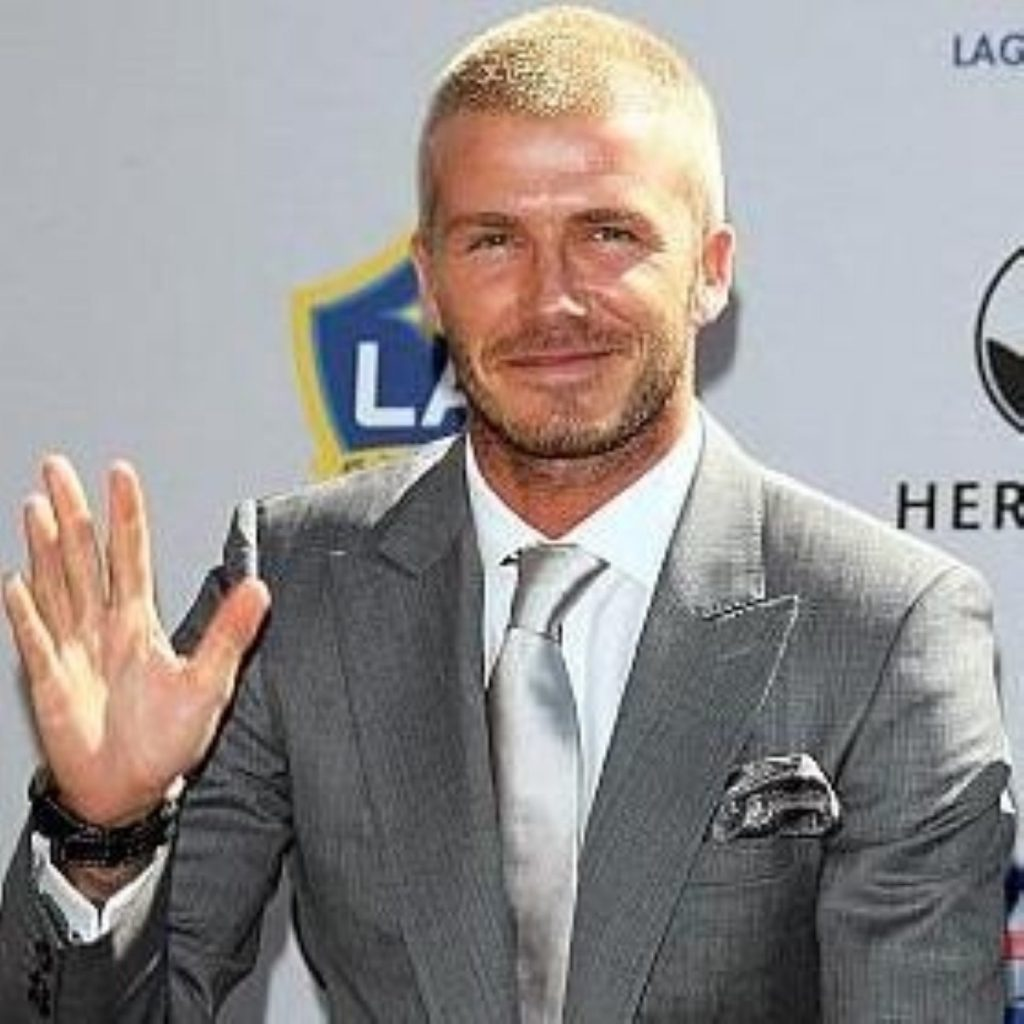Gordon Brown hopes Beckham's fame could win World Cup
