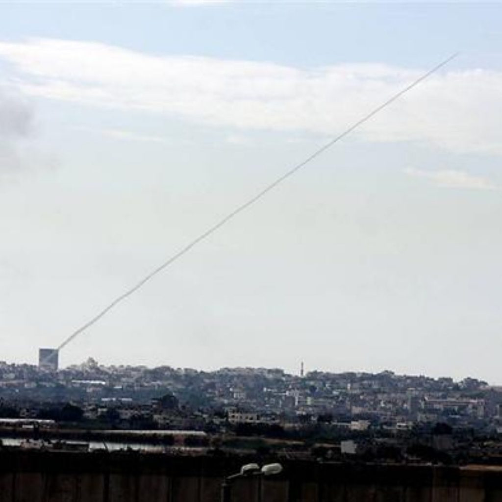 A rocket is fired from Gaza into Israel.