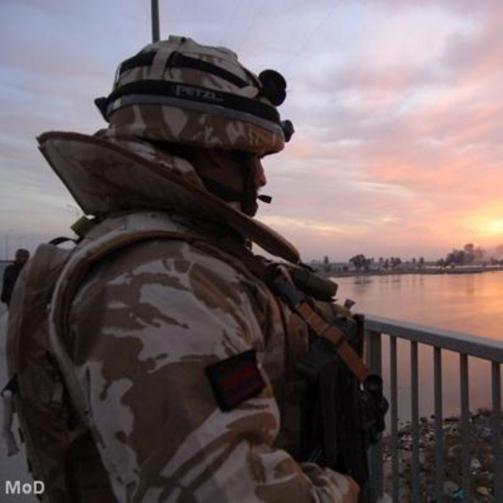 A UK soldier looks out on Iraq. MPs voted on war before the invasion took place.