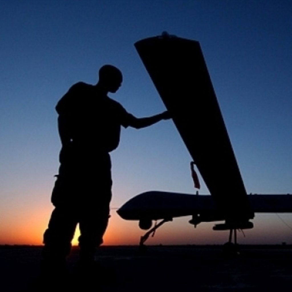 A US serviceman stands by an unmanned drone. the use of the machines has been condemned by human rights groups as an example of extra-judicial assassination.