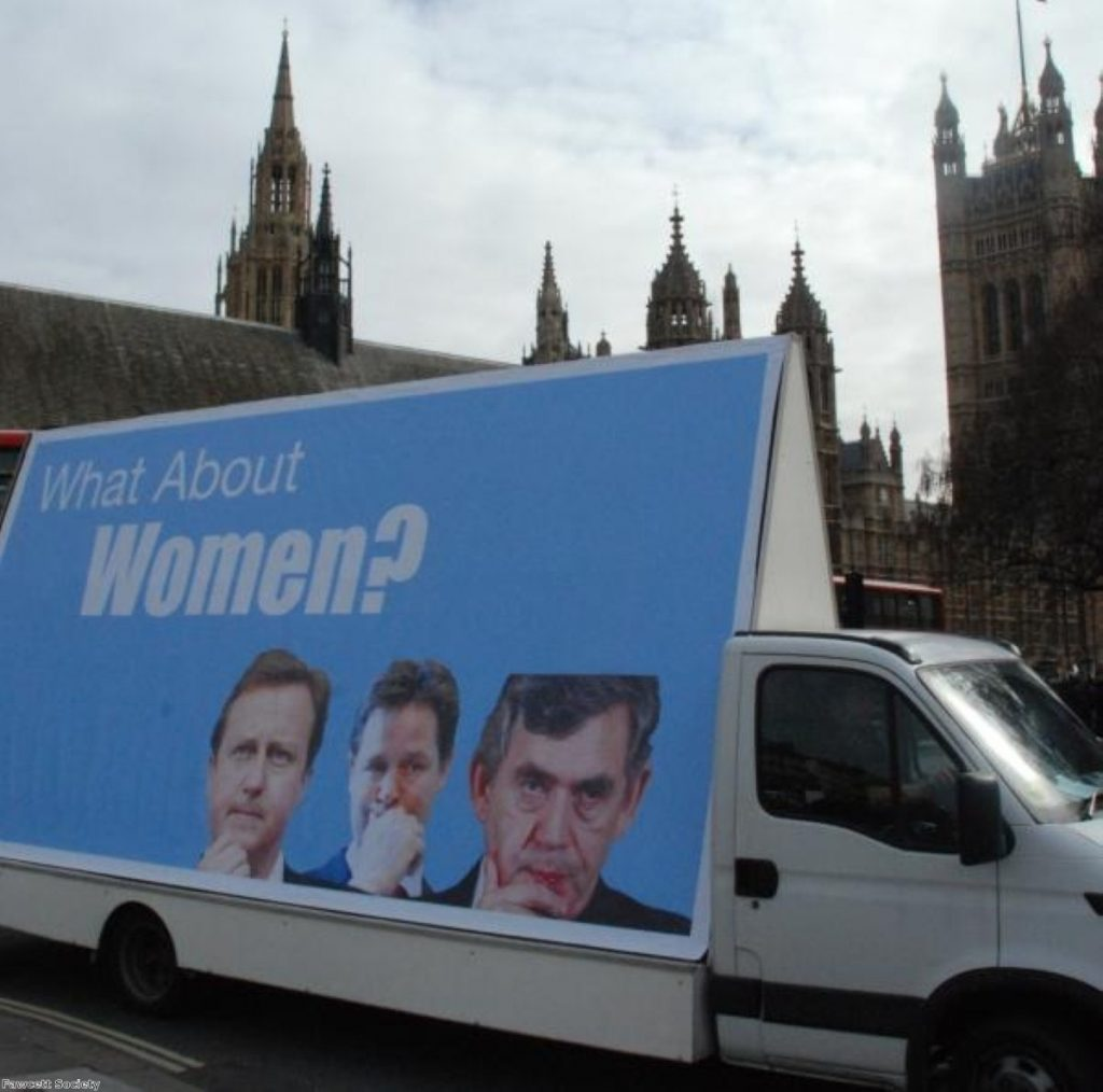 A woman's group drives an advertising billboard around parliament during the 2010 general election.
