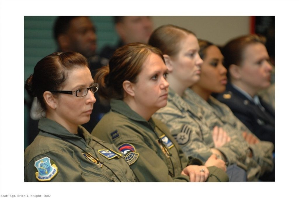 Women in the armed forces receive a briefing. Many younger women struggle to believe their predecessors' were not given equal rights at work.