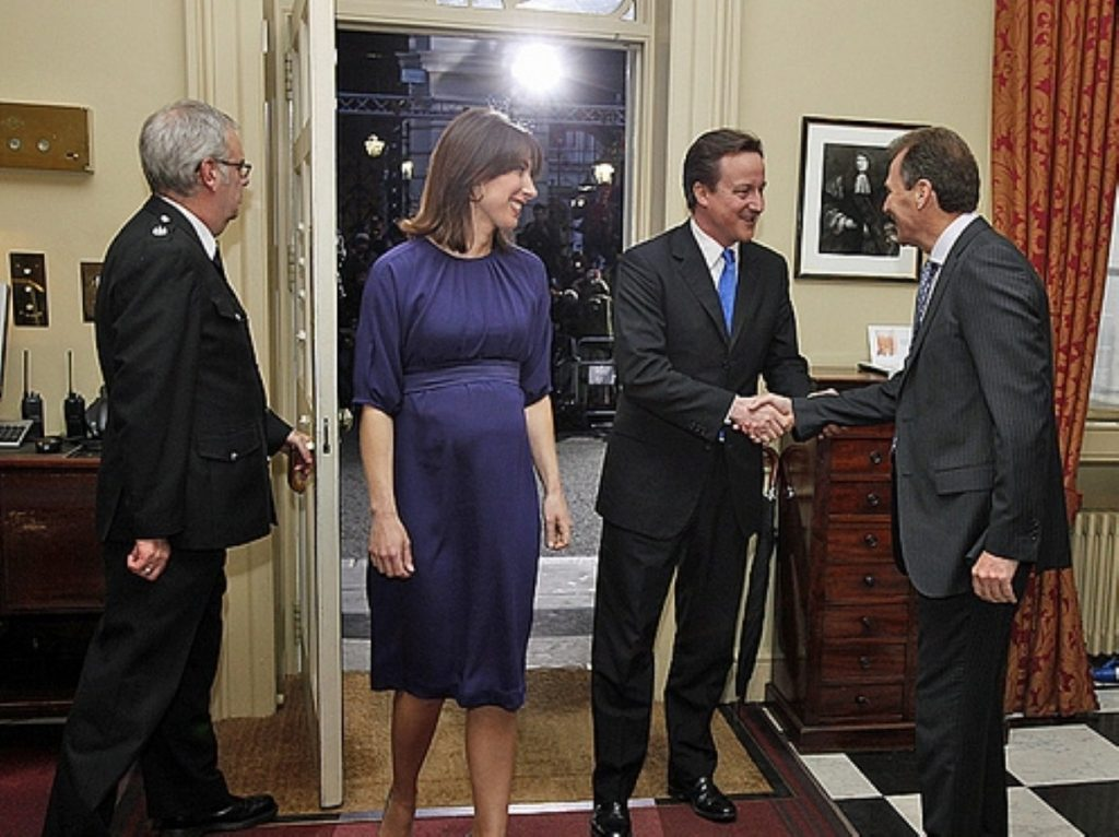 Sir Gus welcomes the Camerons as they arrive in Downing Street following the 2010 general election