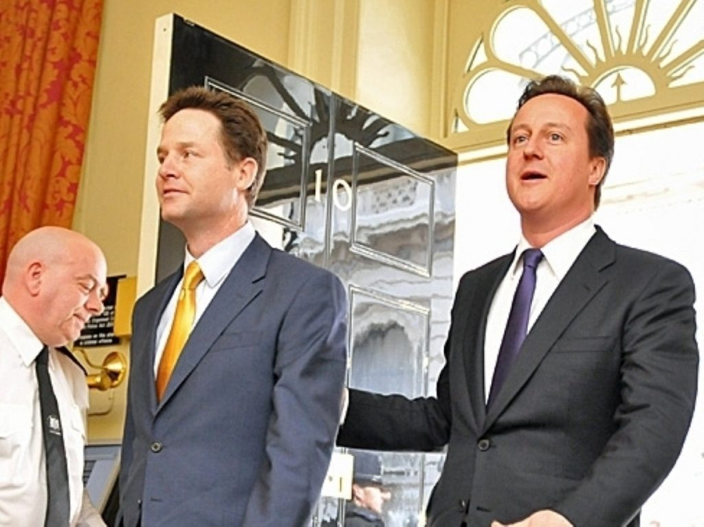 Clegg and Cameron walk into Number 10 together