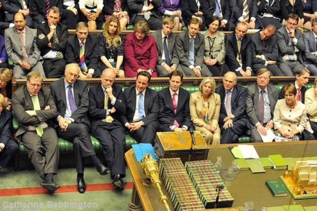 David Cameron enjoys the view from the government benches during the Queen's Speech debate