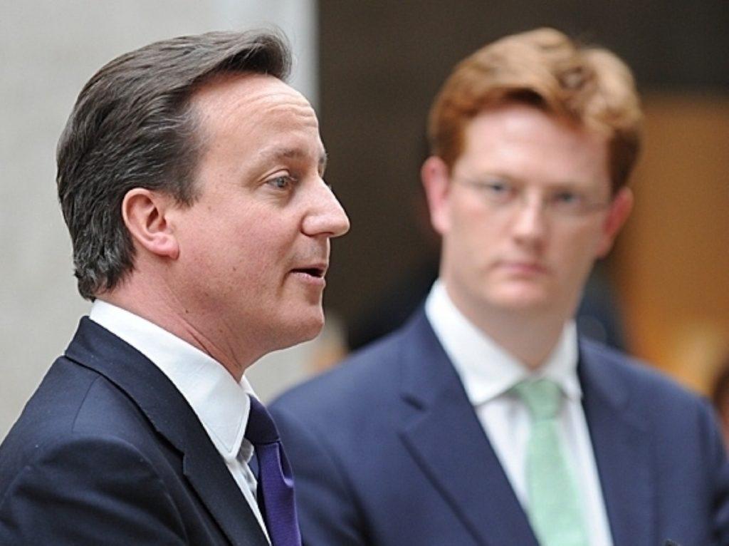Danny Alexander looks on as David Cameron gives a speech