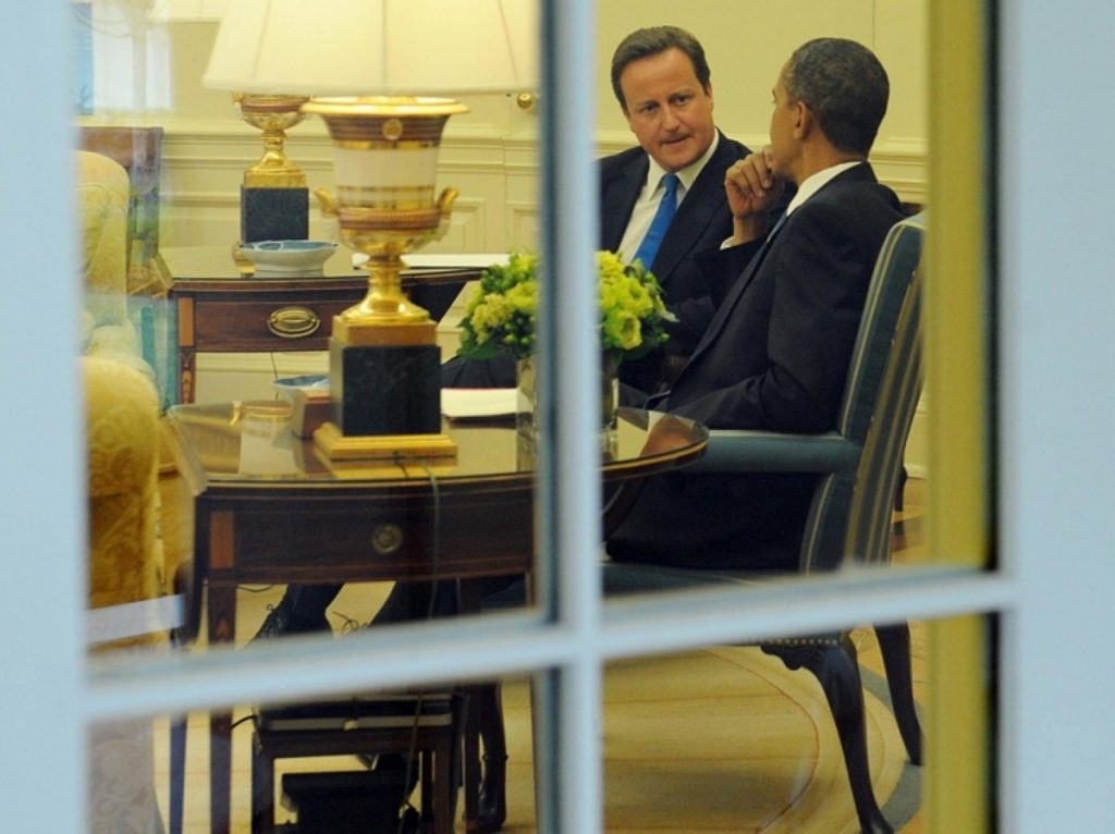 David Cameron listens intently during talks with Barack Obama today