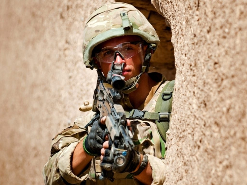 A soldier looks out from cover in Afghanistan. Could troops end up being sent to help out in Mali?