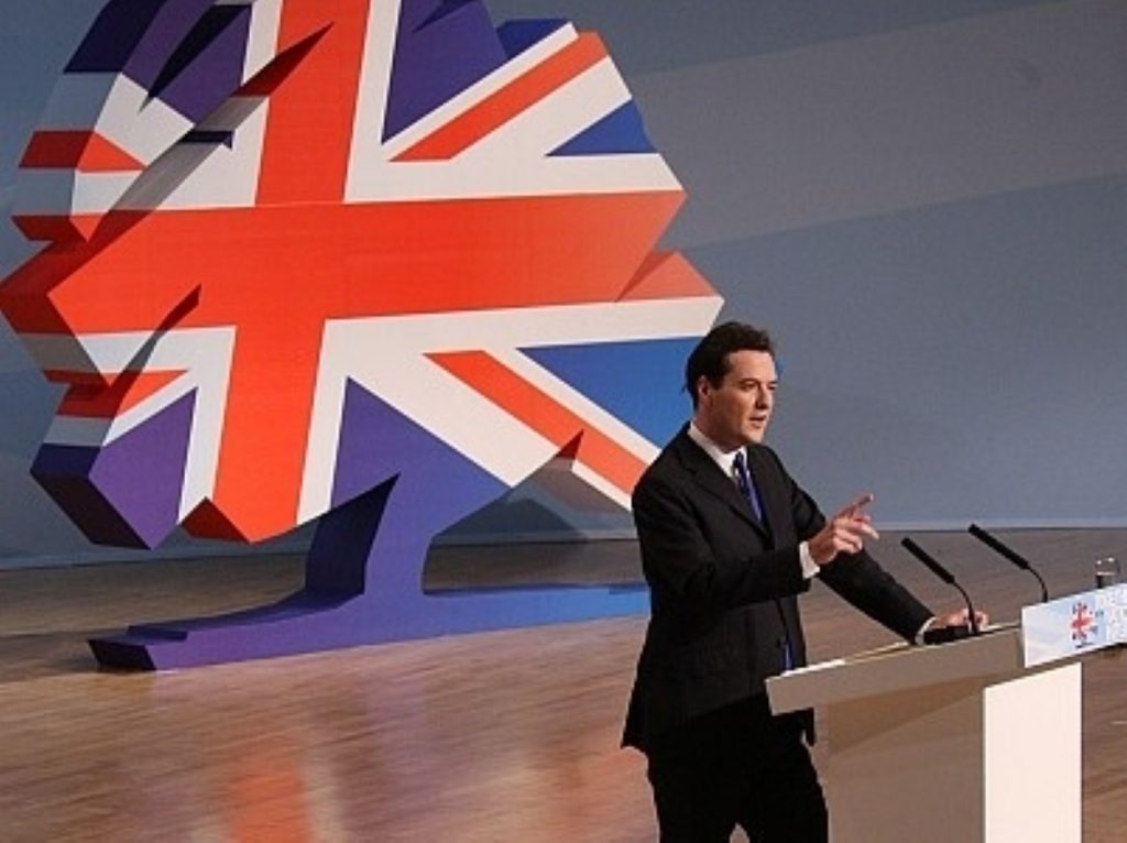 George Osborne on stage, David Cameron somewhere in the audience