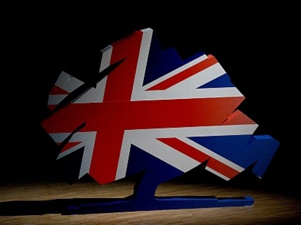 The new Tory logo stands in the conference hall