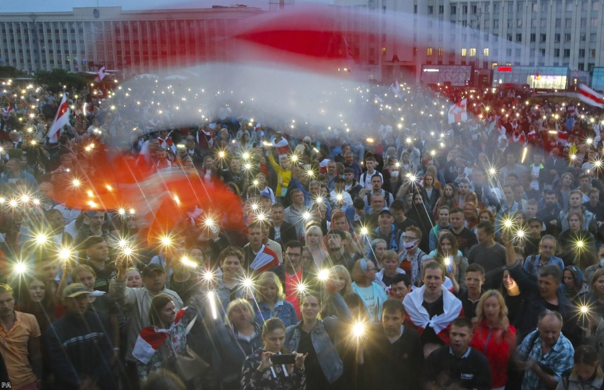Belarusian opposition supporters light phones during a demonstration. The battle over the internet could define the way events play out.